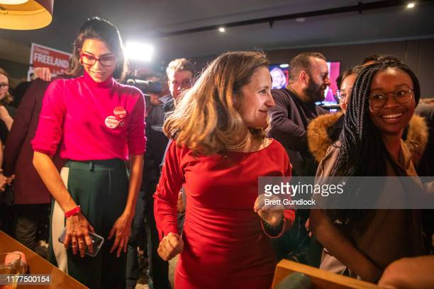 Newly reelected Liberal party member Chrystia Freeland hugs a supporter following Canada's 43rd general election at The Peacock Public House on...