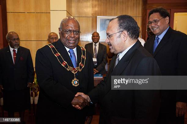 Newly reelected Papua New Guinea Prime Minister Peter O'Neill holshakes hands with Governor General Michael Ogio in Port Moresby on August 3 2012...