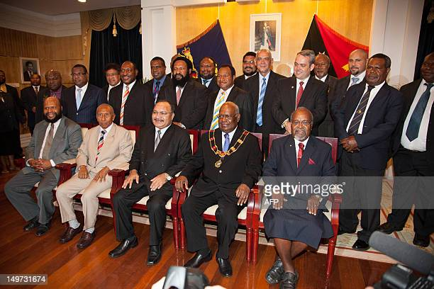 Newly reelected Papua New Guinea Prime Minister Peter O'Neill poses for a group photograph with his cabinet in Port Moresby on August 3 2012 O'Neill...