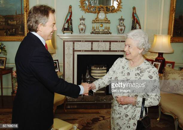 Newly re-elected Prime Minister Tony Blair shakes hands with Queen Elizabeth II during an engagement at Buckingham Palace May 6, 2005 in London....