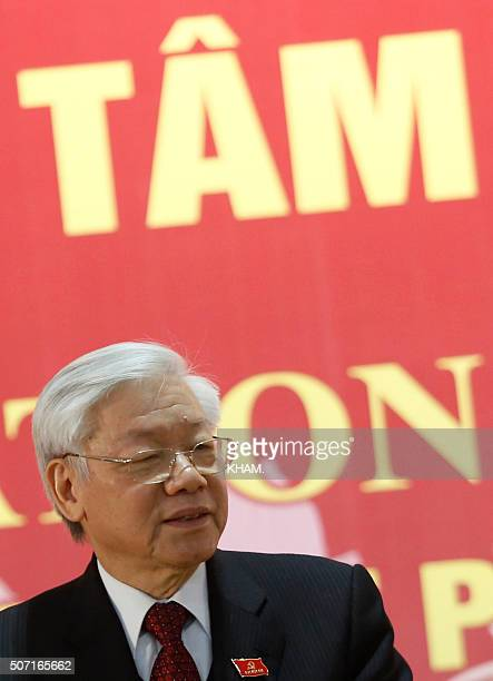 Newly reelected Vietnam Communist Party Secretary General Nguyen Phu Trong speaks at a press conference after the closing ceremony on the final day...