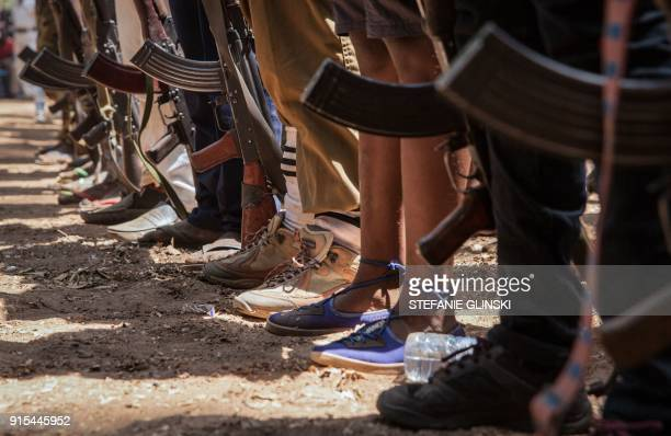 TOPSHOT Newly released child soldiers stand with rifles during their release ceremony in Yambio South Sudan on February 7 2018 More than 300 child...