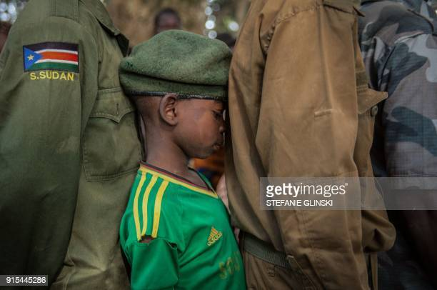 TOPSHOT Newly released child soldiers wait in a line for their registration during the release ceremony in Yambio South Sudan on February 7 2018 More...
