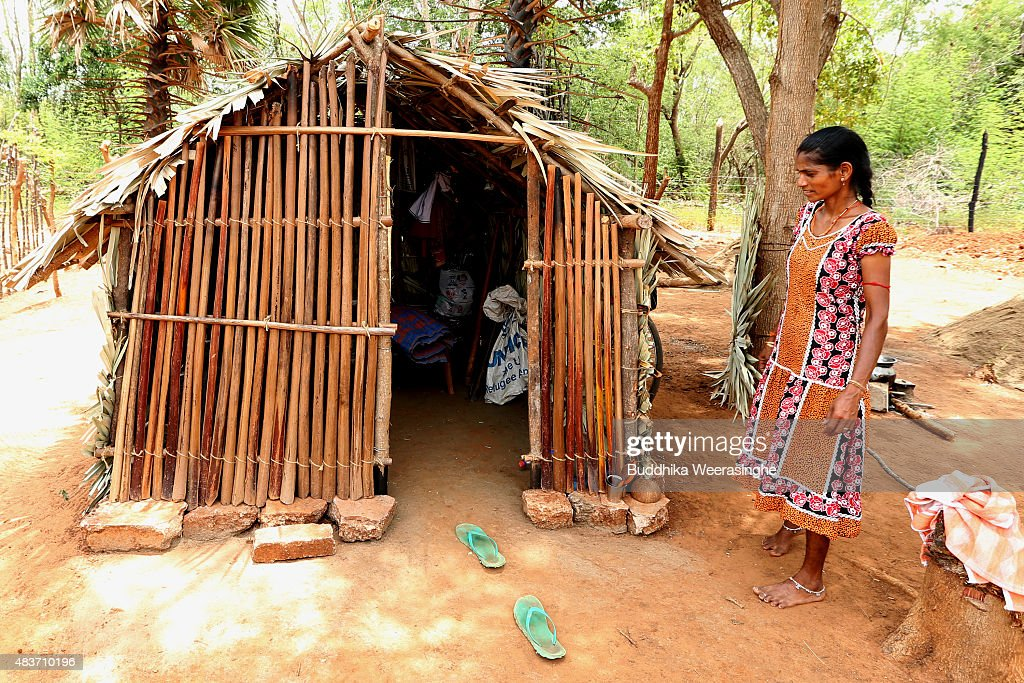 A Newly resettle minority ethnic Tamil woman stands next to her temporary shelter in the land which has been recently released back to owners in April after 25 years as a military forces high security zone in the remote village of Thillipali on August 12,2015 in Jaffna, Sri Lanka. The UN's Human Rights Council investigation into alleged war crimes committed by both the Sri Lankan Government and the Liberation Tigers of Tamil Eelam (LTTE) during the Sri Lankan Civil War is due to be released in September.