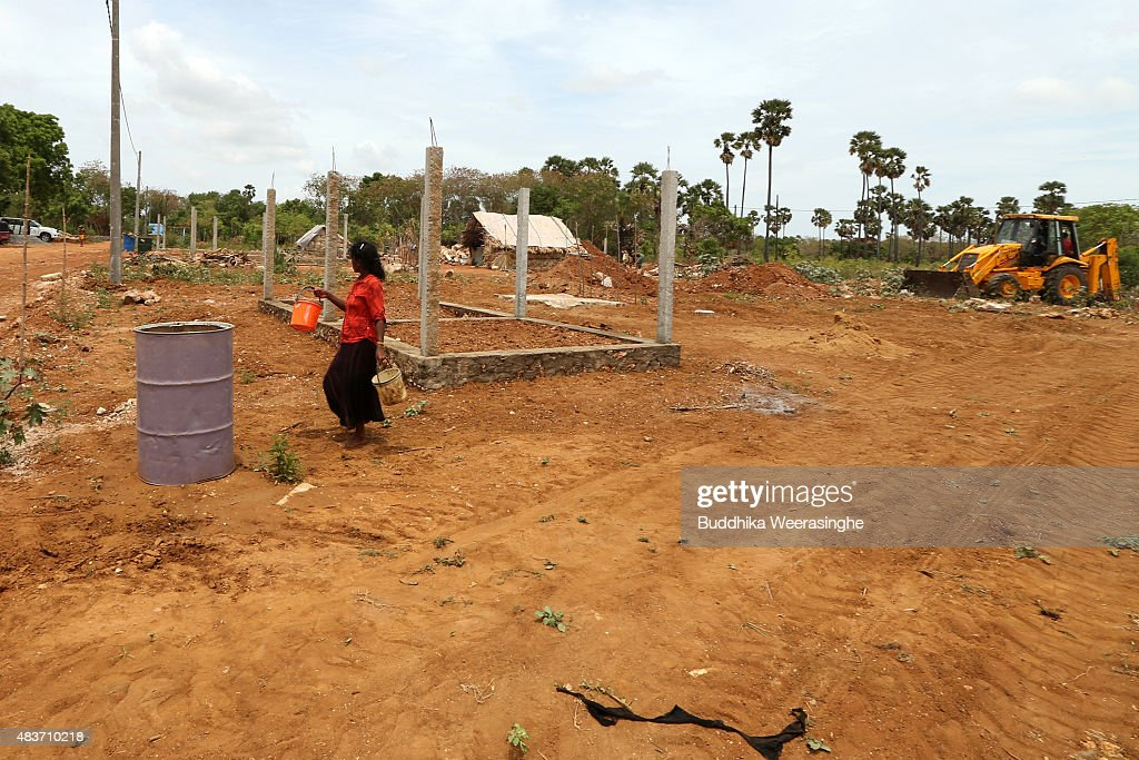 A Newly resettled minority ethnic Tamil woman collects water in the land which has been recently released back to owners in April after 25 years as a military forces high security zone in the remote village of Thillipali on August 12,2015 in Jaffna, Sri Lanka. The UN's Human Rights Council investigation into alleged war crimes committed by both the Sri Lankan Government and the Liberation Tigers of Tamil Eelam (LTTE) during the Sri Lankan Civil War is due to be released in September.