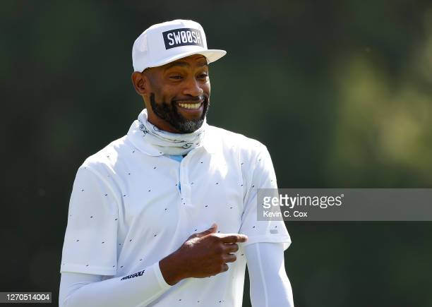 """Newly retired NBA player Vince Carter enjoys a laugh on the 17th hole during the """"Golf With a Purpose"""" Charity Challenge at East Lake Golf Club on..."""