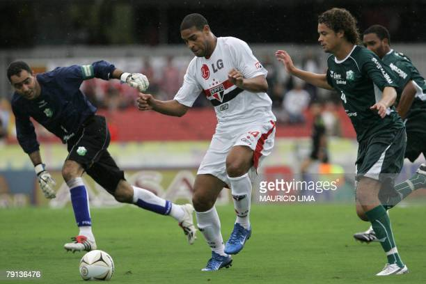 Newly Sao Paulo's jersey Adriano prepares a kick next to Rio Preto's Jeferson during Adriano's first match at Morumbi stadium for their Paulista...