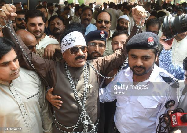 A newly selected member of provincial Assembly and member of Pakistan Muslim League Nawaz party wears chains in a protest for the former Pakistani...