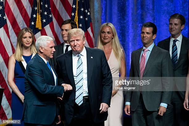 Newly selected vice presidential running mate Mike Pence governor of Indiana shakes hands with Republican presidential candidate Donald Trump at the...