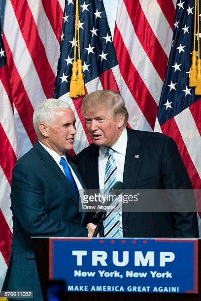 Newly selected vice presidential running mate Mike Pence governor of Indiana stands with Republican presidential candidate Donald Trump during an...