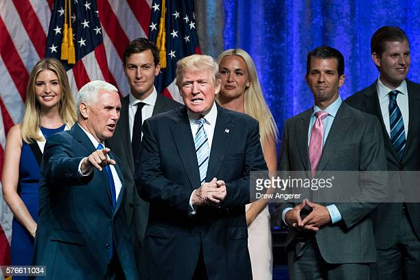 Newly selected vice presidential running mate Mike Pence governor of Indiana stands onstage with Republican presidential candidate Donald Trump and...