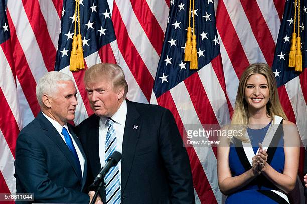 Newly selected vice presidential running mate Mike Pence governor of Indiana stands with Republican presidential candidate Donald Trump as Ivanka...