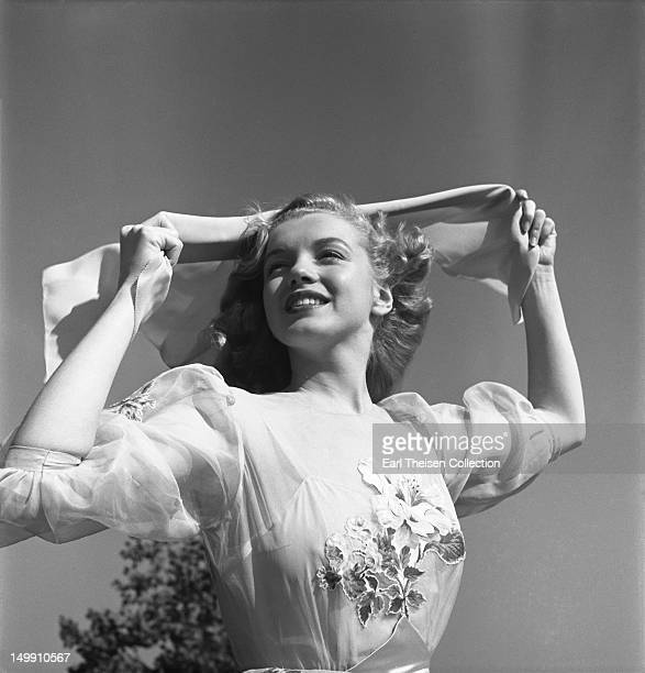 Newly signed 20th Century-Fox contract girl Marilyn Monroe poses for a portrait in 1947 in Los Angeles, California.