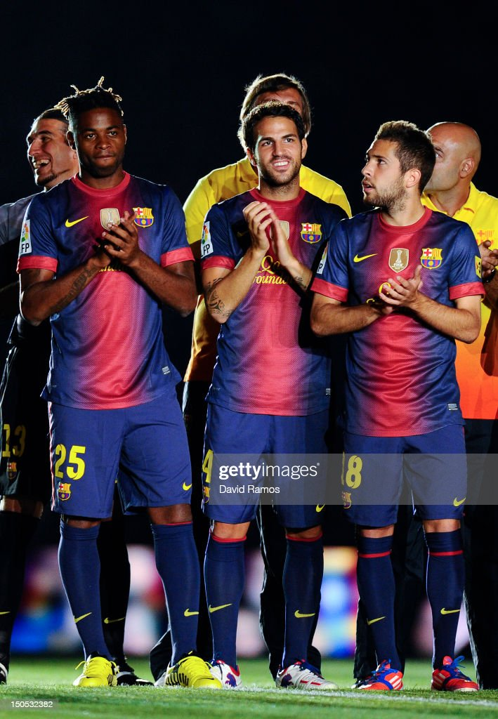 Newly signed FC Barcelona player Alex Song (L), Cesc Fabregas (C) and Jordi Alba of FC Barcelona look on prior to the Joan Gamper Trophy friendly match between FC Barcelona and Sampdoria at Camp Nou on August 20, 2012 in Barcelona, Spain.