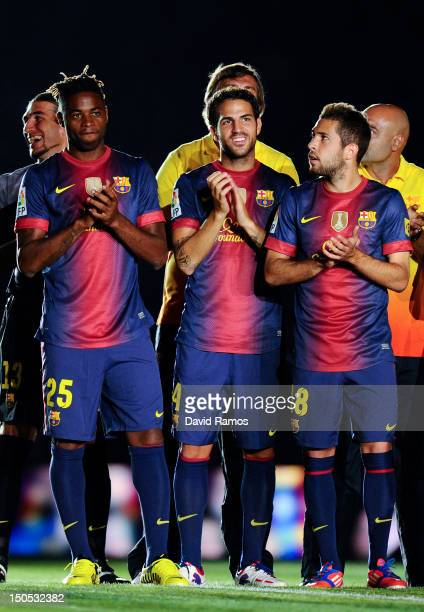 Newly signed FC Barcelona player Alex Song Cesc Fabregas and Jordi Alba of FC Barcelona look on prior to the Joan Gamper Trophy friendly match...