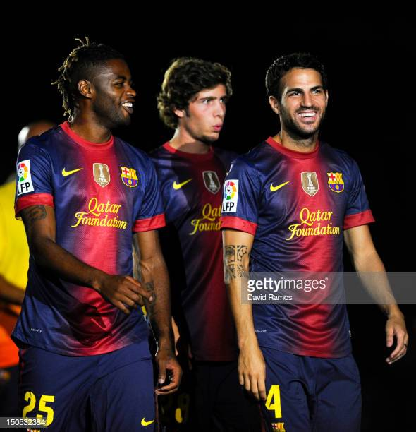 Newly signed FC Barcelona player Alex Song jokes with his new teammate Cesc Fabregas prior to the Joan Gamper Trophy friendly match between FC...