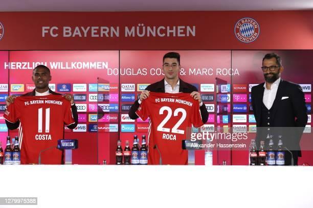 Newly signed FC Bayern Muenchen players Douglas Costa and Marc Roca pose next to Hasan Hasan Salihamidžić, sporting director of FC Bayern Muenchen...