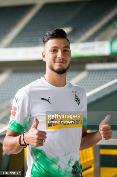 Newly signed player Ramy Bensebaini pose for a picture at BorussiaPark on August 14 2019 in Moenchengladbach Germany