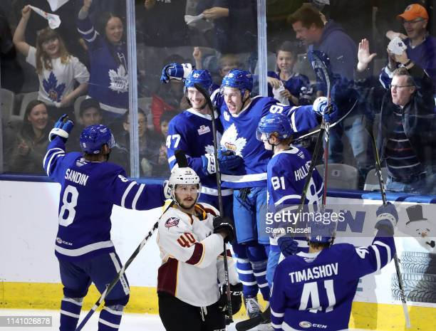 TORONTO ON MAY 3 Newly signed Toronto Marlies forward Egor Korshkov is congratulated by teammates after scoring his first AHL goal as the Toronto...