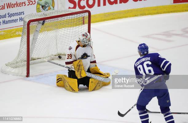 Newly signed Toronto Marlies forward Egor Korshkov scores his first AHL goal getting the puck past Cleveland Monsters goaltender Brad Thiessen in the...