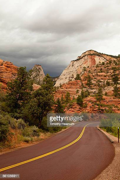 newly surfaced road through red rock country - timothy hearsum stock photos and pictures