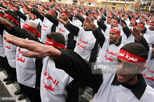 Newly sworn in Hezbollah 'Fighters for Gaza' salute during a ceremony in the southern Lebanese town of Qana on January 18 2009 The ceremony was...
