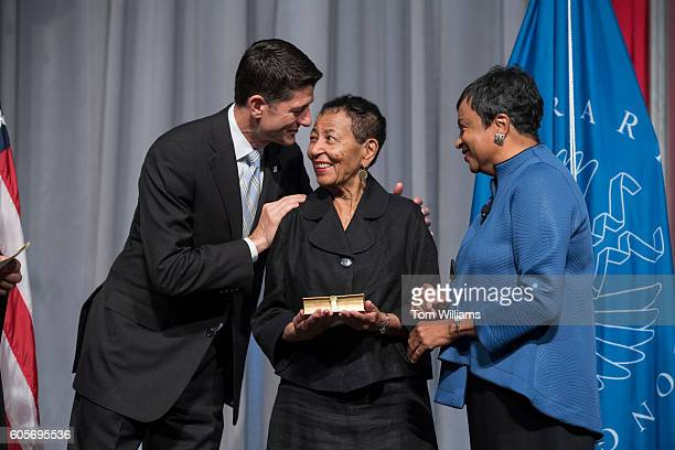 Newly sworn in Librarian of Congress Carla Hayden right her mother Colleen and Speaker Paul Ryan RWis are seen during a ceremony in the Great Hall of...