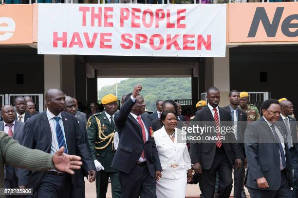 Newly sworn in President Emmerson Mnangagwa arrives with his wife Auxilia at the National Sport Stadium in Harare on November 24 2017 during the...