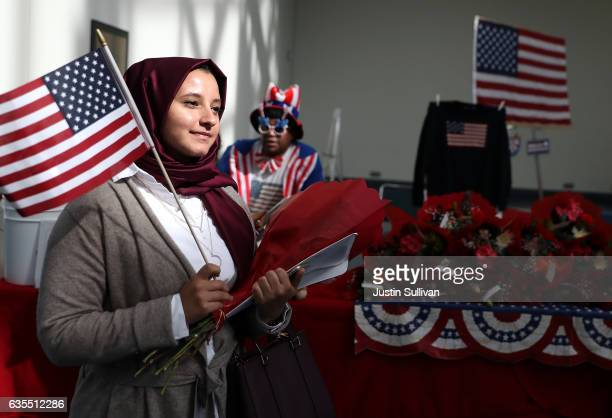 A newly sworn in US citizen leaves a naturalization ceremony held by US Citizenship and Immigration Services at the Los Angeles Convention Center on...