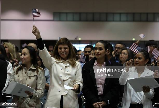 Newly sworn in US citizens celebrate during a naturalization ceremony held by US Citizenship and Immigration Services at the Los Angeles Convention...
