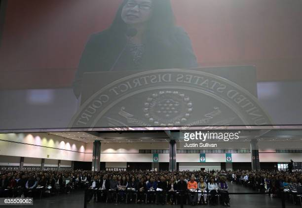 Newly sworn in US citizens reeive instructions during a naturalization ceremony held by US Citizenship and Immigration Services at the Los Angeles...