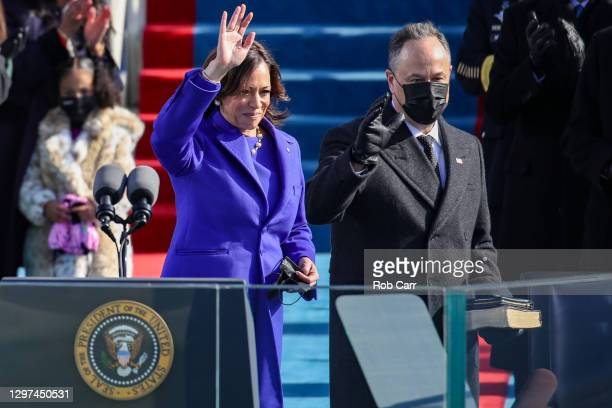 Newly sworn in Vice President Kamala Harris and husband Doug Emhoff wave to the crowd during the inauguration of U.S. President-elect Joe Biden on...