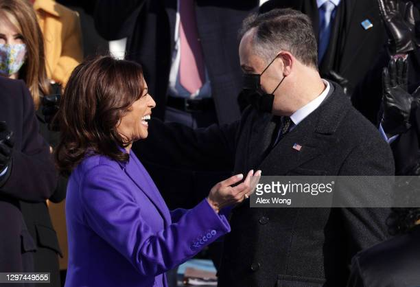 Newly sworn in Vice President Kamala Harris hugs her husband Doug Emhoff during the inauguration of U.S. President-elect Joe Biden on the West Front...
