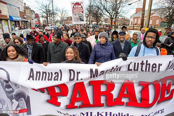 Newly sworn in Washington DC Mayor Murial Bowser center right walks in the annual Martin Luther King Peace March and parade in Southeast on Martin...