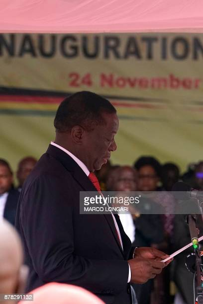 Newly sworn in Zimbabwe's president Emmerson Mnangagwa takes the oath of office at the national sports stadium on the outskirts of Harare on November...