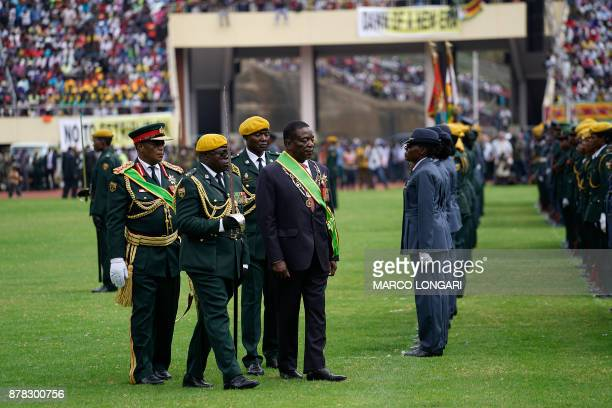 Newly sworn in Zimbabwe's president Emmerson Mnangagwa walks after taking the oath of office at the national sports stadium on the outskirts of...
