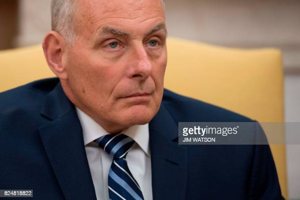 Newly swornin White House Chief of Staff John Kelly looks on in the Oval Office of the White House in Washington DC on July 31 2017 US President...