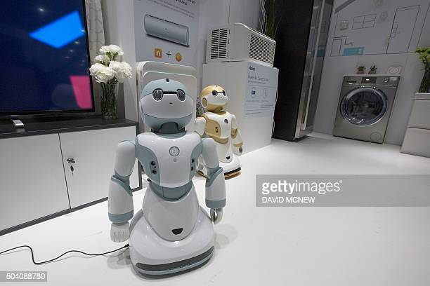 Newly unveiled Haier Ubot household robots are shown in a kitchen display at the CES 2016 Consumer Electronics Show on January 8 2016 in Las Vegas...