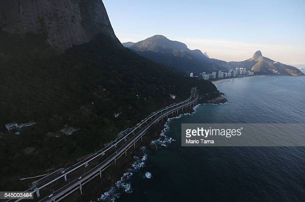 A newly upgraded highway passes along the Atlantic Ocean on July 4 2016 in Rio de Janeiro Brazil July 5 marks the onemonth mark to the beginning of...