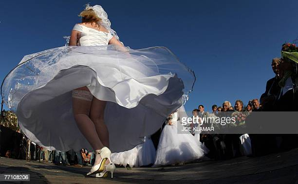 A newly wed bride dances at Michail's square in Kiev 29 September 2007 where seventy couples took part in a mass wedding AFP PHOTO/JOE KLAMAR