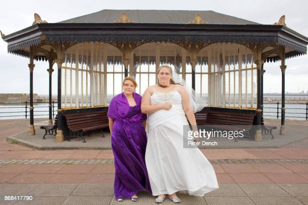 Newly wed Claire SimonKind with sister and bridesmaid Sarah Simon in front of a weather shelter on New Brighton promenade In 1986 world famous...