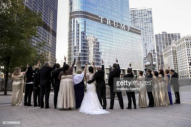 A newly wed couple and their friends attend a protest against Presidentelect Donald Trump outside the Trump Tower in Chicago Illinois USA 12 November...