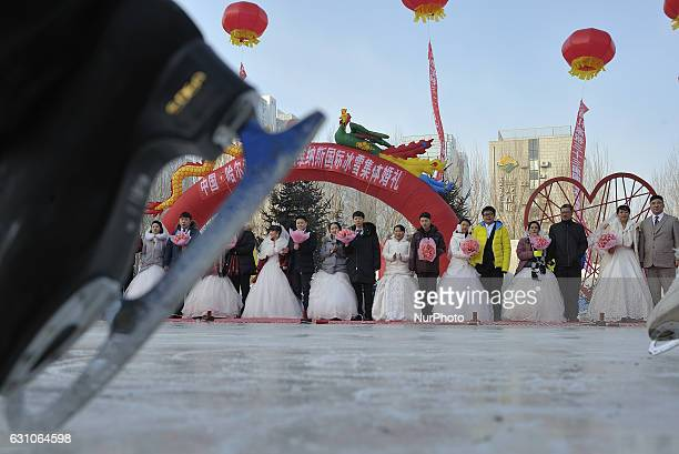 Newly wed couples attend a mass wedding ceremony at the 33rd Harbin International Ice and Snow Festival in Harbin China's northern Heilongjiang...