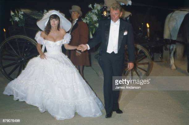 Newly wed Johnny Hallyday and Adeline Blondieau arriving at their wedding reception Saint Tropez 09th July 1990