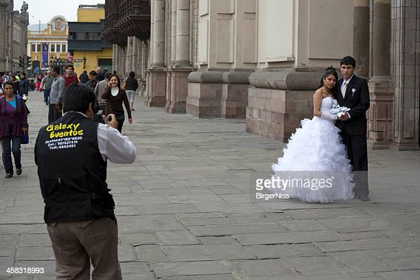Newly wed peruvian couple being photographed