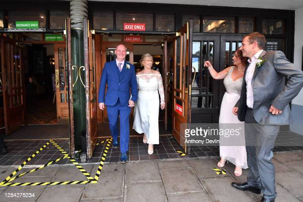 Newly weds Stuart and Diana Greenwood celebrate their wedding day at the Regal Moon JD Wetherspoons pub on July 04, 2020 in Rochdale, England. The UK...