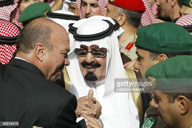 Newlyanointed Saudi King Abdullah and former Jordanian prime minister Faisal alFayez attend the funeral the late King Fahd at the Imam Turki bin...