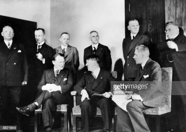 Newlyappointed chancellor Adolf Hitler surrounded by members of his cabinet Sitting from left Goering Hitler von Papen Standing from left Lammers...