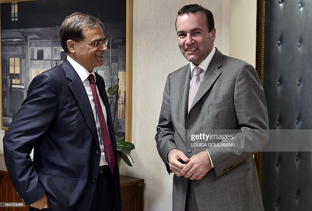 Newly-appointed European Popular Party chairman Manfred Weber (R) arrives to meet with Greek Finance Minister Gikas Hardouvelis prior to a meeting in Athens on August 26, 2014.