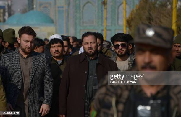 Newlyappointed governor of the Afghan province of Balkh Mohammad Daud attends the funeral of his father in MazariSharif on January 17 2018 A powerful...
